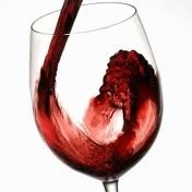 red wine being poured in a glass